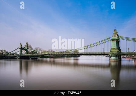 Long exposure on the River Thames at Hammersmith Bridge, London, UK - Stock Image