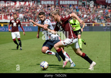 Turin, Italy. 14th Apr, 2019.  Serie A football, Torino versus Cagliari; Paolo Farago of Cagliari chases down Cristian Ansaldi of Torino FC Credit: Action Plus Sports Images/Alamy Live News Credit: Action Plus Sports Images/Alamy Live News - Stock Image