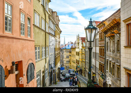 Tourists walk up the long staircase past shops and apartments on their way to the Prague Castle Complex in Prague, Czech Republic - Stock Image