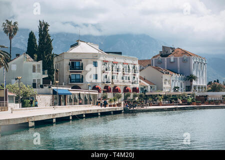 Beautiful view of the architecture of the coastal city of Tivat in Montenegro against the backdrop of the sea and mountains. - Stock Image