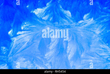 Ice on a window, background, patterns and shapes of ice blue and white colors - Stock Image