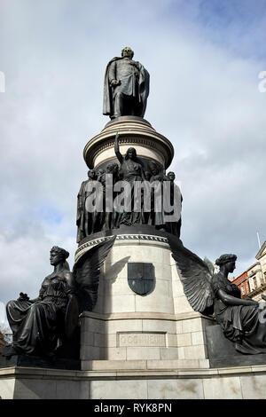 daniel oconnell statue on oconnell street Dublin Republic of Ireland europe oconnell on top of figures representing labour and triumph above winged vi - Stock Image