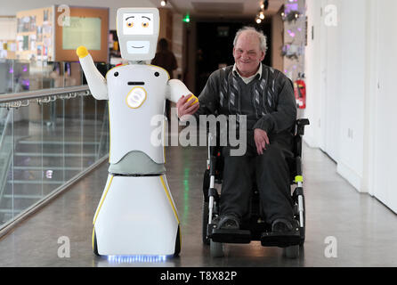 IrelandÕs first socially assistive AI robot 'Stevie II' from robotics engineers at Trinity College Dublin, with Brendan Crean, who helped trial the robot through the charity ALONE, during a special demonstration at the Science Gallery in Dublin. - Stock Image