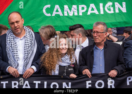 London, UK. May 11th 2019. National Demonstration for Palestine. Thousands of activists marched from Portland Place to Whitehall. Organised by the Palestine Solidarity Campaign, Stop the War Coalition, Palestinian Forum in Britain, Friends of Al- Aqsa & Muslim Association of Britain. Pictured, Palestinian activist Ahed Tamimi (centre) joins National Demonstration for Palestine, with father Bassem Tamimi (right) and Palestine Mission Ambassador Husam S. Zomlot (left). Credit: Stephen Bell/Alamy Stock Photo - Stock Image
