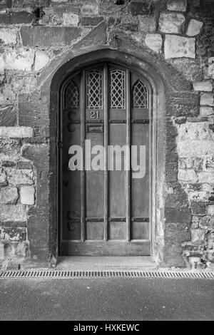 Black and white image of a medieval door. - Stock Image