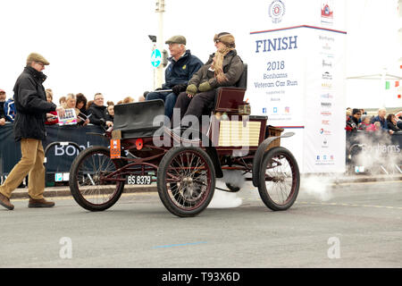 Mr John Blackford driving his1900, Mobile Steam Car, across the finishing line of the 2018 London to Brighton Veteran Car Run - Stock Image