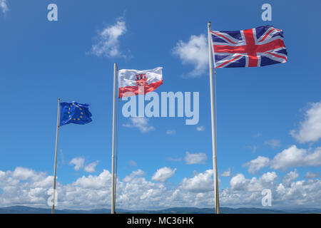 GIBRALTAR, SPAIN: 12-MAY 2017: The EU flag, The Flag of Gibralta and the Union Jack flag on the Rock of Gibraltar in May 2017. - Stock Image