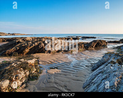 Bovisand Beach and Bay, Devon, UK, at low tide, with clear blue sky. - Stock Image