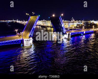Summer night, Saint Petersburg, Russia. Neva River. Drawn bascule moveable Palace bridge. Winter Palace. - Stock Image