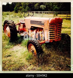 Vintage Red Tractor - Stock Image
