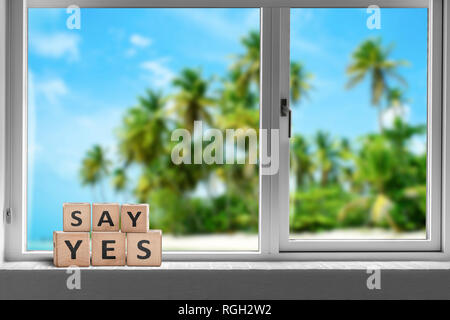 Say yes sign in a window on a tropical beach with palm trees in the summer sun - Stock Image