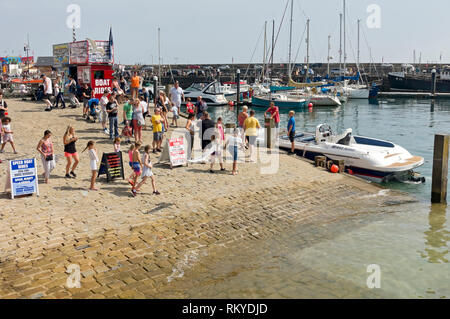 People queuing for speed boat rides. - Stock Image