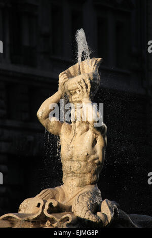 Triton Fountain by Italian Baroque sculptor Gian Lorenzo Bernini at Piazza Barberini in Rome, Italy. - Stock Image