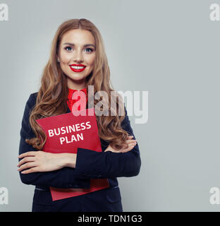 Smart business woman holding business plan - Stock Image