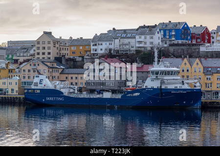 The cargo ship Eidsvaag Pioner in port in the town of Kristiansund in Norway - Stock Image