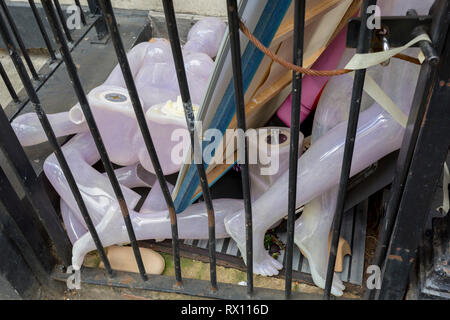The body parts of a retail mannequin lying trapped behind railings in a West End street, on 7th March 2019, in London, England. - Stock Image