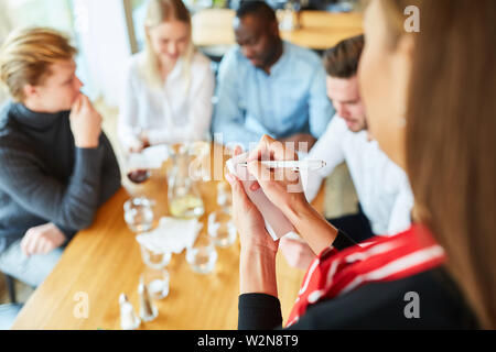 Waitress or waitress makes an order in the bistro or restaurant - Stock Image