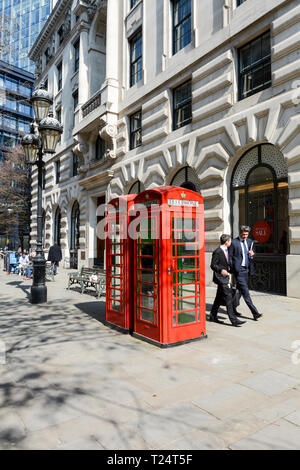 Inoperative Grade II listed red telephone boxes on The Royal Exchange, City of London, UK - Stock Image