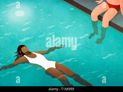 Serene woman floating on back in swimming pool - Stock Image