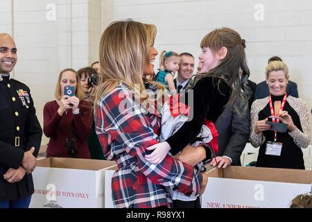 U.S. First Lady Melania Trump greets children during a Toys for Tots Christmas Event at Joint Base Anacostia-Bolling December 11, 2018 in Washington, DC. Toys for Tots is a Marine Corps Program that collects new unwrapped toys and distribute those toys to less fortunate children at Christmas. - Stock Image