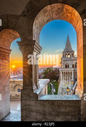 Budapest, Hungary - Sunrise at Fisherman's Bastion (Halaszbastya) through Gothic windows and balcony - Stock Image