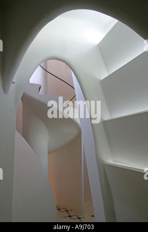 Barcelona Casa Batllo by Antoni Gaudi arcades all in white in the top floor passage stairway - Stock Image