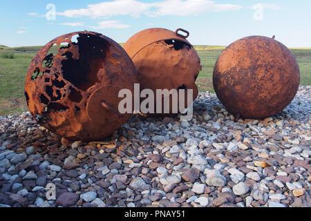 Large iron, discarded rusty sea floats disintegrating on Badentarbat Beach, Coigach, Scotland - Stock Image