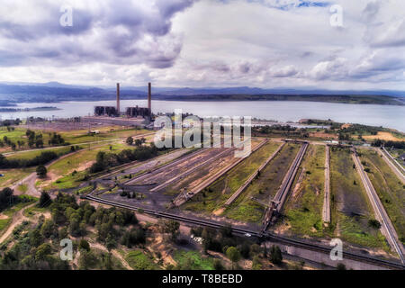 LIddell power station on shores of Liddell lake in Hunter Valley region of Australia burning fossil fuel black coal excavated from open coal mines. - Stock Image