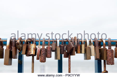 Zandvoort The Netherlands Love locks rusting on the seaside. - Stock Image