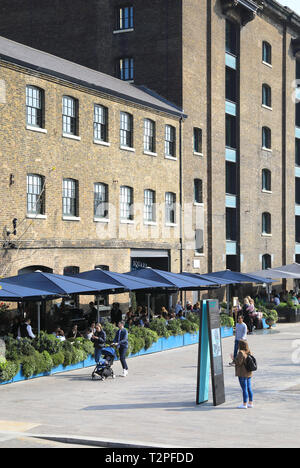 Granary Square Brasserie, in spring sunshine, at Kings Cross, north London, UK - Stock Image