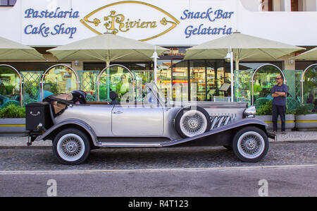 1 October 2017 A luxurious silver grey retro Beauford Limousine parked outside a hotel in Albuferia in Portugal - Stock Image
