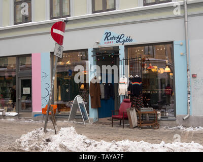 Colorful shop facade with retro clothes for men and home articles, one of many, in the popular Grunerløkka neighborhood of Oslo Norway - Stock Image