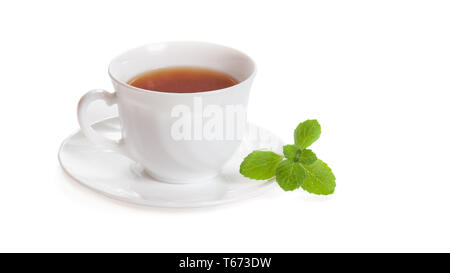 White Cup of tea with mint melissa herb isolated with clipping path - Stock Image