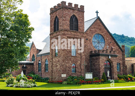 COUDERSPORT, PA, USA-10 AUGUST 18: St Eulalia Catholic Church sets on main street in the small rural town. - Stock Image