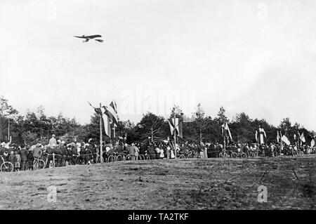 An airplane of the type Grade Libelle flies over the airfield Fichtenwalde near Berlin. - Stock Image