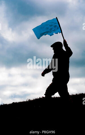 North Yorkshire, England UK - A grouse moor in early autumn as a beater walks to flush the grouse  holding a flag in silhouette - Stock Image