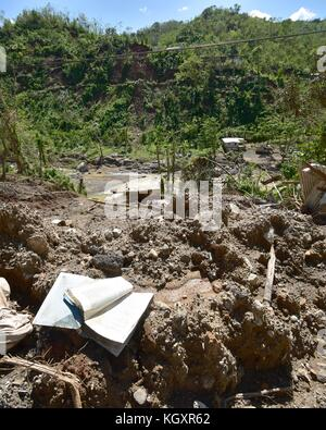 Dirt and debris piles up after a landslide in the aftermath of Hurricane Maria November 2, 2017 in Lares, Puerto - Stock Image