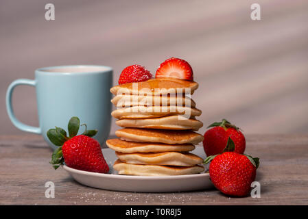 stack of pancakes with strawberries - Stock Image