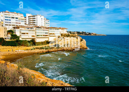 view of the Platja dels Llenguadets cove and the northern coastline of Salou, surrounded by the Cami de Ronda, a walk bordering the ocean, in this fam - Stock Image