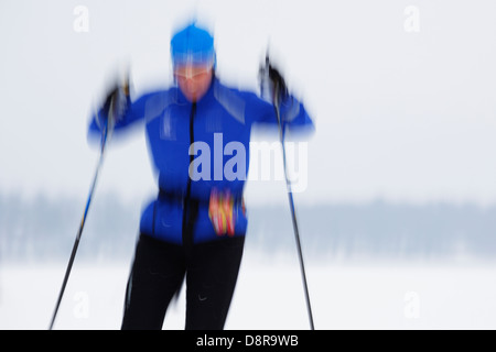 Panning blur of a cross country skier. - Stock Image