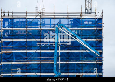Gosford, New South Wales, Australia - September 3. 2018: Construction and building progress update 127. Delivering concrete on new home units building - Stock Image