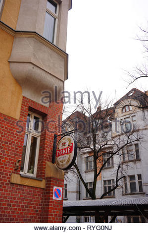 Poznan, Poland - March 8, 2019: Tyskie beer brand sign on a wall at the Slowackiego street in the city center. - Stock Image