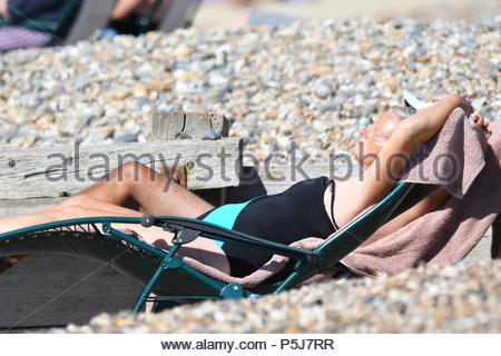 Littlehampton, UK. Wednesday 27th June 2018. People laying on the beach on another very warm and sunny morning in Littlehampton, on the South Coast. Credit: Geoff Smith / Alamy Live News. - Stock Image