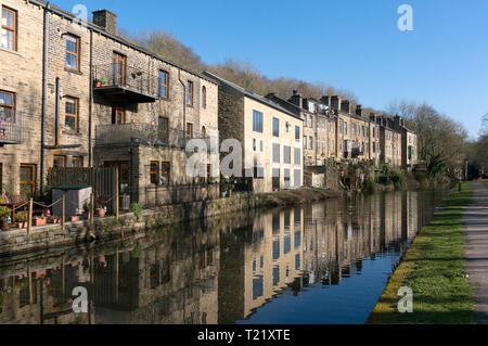 Row of old canalside houses with sympathetic new build in the centre, Luddenden Foot, West Yorkshire - Stock Image