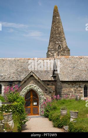 UK, Cornwall, Trebetherick, Daymer Bay, Saint Enodoc's Church spire and wedding flowers around porch - Stock Image