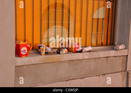 Food trash left on window ledge after eating at McDonalds - Stock Image