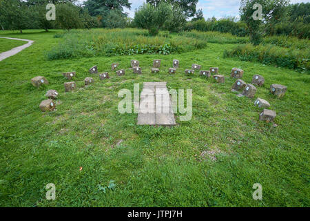 Two rows of stones to account for Daylight Savings Time on a human sundial. A human stood on the paving would be the gnomon casting the shadow. - Stock Image