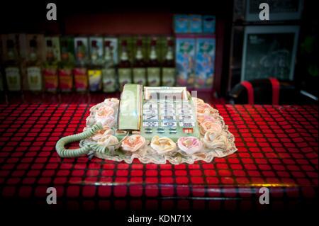 Funny telephone à la réception dans un restaurant dans la vieille ville de Kaesong le 8octobre 2012. Funny - Stock Image