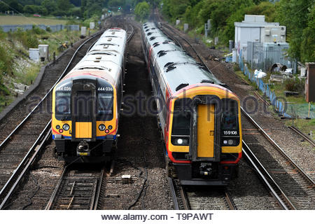 File photo dated 10/06/15 of two trains near a station. According to new analysis by consumer group Which?, rail passengers lost an estimated four million hours to significantly delayed trains in 2018. - Stock Image