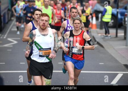 Brighton, Sussex, UK. 14th Apr, 2019. The early leaders in this years Brighton Marathon which is celebrating its 10th anniversary Credit: Simon Dack/Alamy Live News - Stock Image